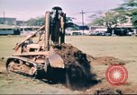 Image of Digging air raid shelters in Hawaii at start of World War II Hawaii USA, 1942, second 14 stock footage video 65675062971