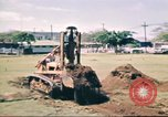 Image of Digging air raid shelters in Hawaii at start of World War II Hawaii USA, 1942, second 16 stock footage video 65675062971