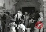 Image of Annual pilgrimage to Nabi Musa (Tomb of Prophet Moses) Palestine, 1945, second 24 stock footage video 65675062974