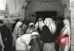 Image of Annual pilgrimage to Nabi Musa (Tomb of Prophet Moses) Palestine, 1945, second 32 stock footage video 65675062974