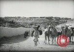Image of Small boy walking with camels Amman Transjordan, 1945, second 14 stock footage video 65675062976