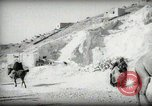 Image of Small boy walking with camels Amman Transjordan, 1945, second 25 stock footage video 65675062976