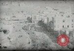 Image of Small boy walking with camels Amman Transjordan, 1945, second 44 stock footage video 65675062976