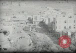 Image of Small boy walking with camels Amman Transjordan, 1945, second 45 stock footage video 65675062976