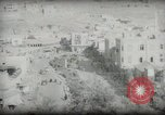 Image of Small boy walking with camels Amman Transjordan, 1945, second 46 stock footage video 65675062976