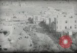 Image of Small boy walking with camels Amman Transjordan, 1945, second 47 stock footage video 65675062976
