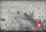 Image of Small boy walking with camels Amman Transjordan, 1945, second 48 stock footage video 65675062976