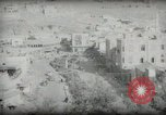 Image of Small boy walking with camels Amman Transjordan, 1945, second 49 stock footage video 65675062976