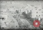 Image of Small boy walking with camels Amman Transjordan, 1945, second 51 stock footage video 65675062976