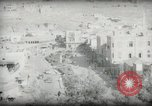 Image of Small boy walking with camels Amman Transjordan, 1945, second 52 stock footage video 65675062976