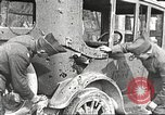 Image of US soldiers examine gunfire damaged car France, 1917, second 2 stock footage video 65675063072