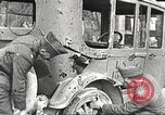 Image of US soldiers examine gunfire damaged car France, 1917, second 3 stock footage video 65675063072