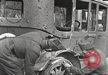 Image of US soldiers examine gunfire damaged car France, 1917, second 4 stock footage video 65675063072