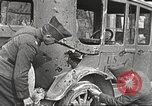 Image of US soldiers examine gunfire damaged car France, 1917, second 5 stock footage video 65675063072
