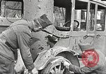 Image of US soldiers examine gunfire damaged car France, 1917, second 6 stock footage video 65675063072