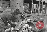 Image of US soldiers examine gunfire damaged car France, 1917, second 7 stock footage video 65675063072