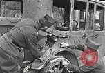 Image of US soldiers examine gunfire damaged car France, 1917, second 8 stock footage video 65675063072