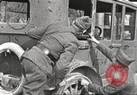 Image of US soldiers examine gunfire damaged car France, 1917, second 9 stock footage video 65675063072