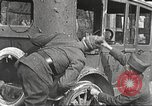 Image of US soldiers examine gunfire damaged car France, 1917, second 10 stock footage video 65675063072