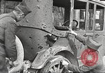 Image of US soldiers examine gunfire damaged car France, 1917, second 11 stock footage video 65675063072
