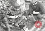 Image of US soldiers examine gunfire damaged car France, 1917, second 14 stock footage video 65675063072