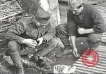 Image of US soldiers examine gunfire damaged car France, 1917, second 15 stock footage video 65675063072