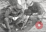 Image of US soldiers examine gunfire damaged car France, 1917, second 22 stock footage video 65675063072