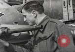 Image of German aircraft in British town square United Kingdom, 1941, second 8 stock footage video 65675063095