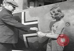 Image of German aircraft in British town square United Kingdom, 1941, second 11 stock footage video 65675063095