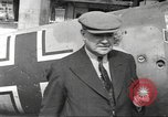 Image of German aircraft in British town square United Kingdom, 1941, second 13 stock footage video 65675063095