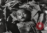 Image of victims of Nazi and Japanese atrocities in World War 2 Europe, 1945, second 13 stock footage video 65675063143