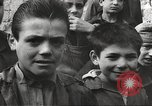 Image of European children and adults scavenge for food and relief after war Europe, 1945, second 3 stock footage video 65675063144