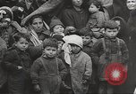 Image of European children and adults scavenge for food and relief after war Europe, 1945, second 5 stock footage video 65675063144