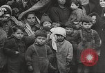 Image of European children and adults scavenge for food and relief after war Europe, 1945, second 6 stock footage video 65675063144