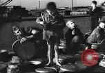 Image of European children and adults scavenge for food and relief after war Europe, 1945, second 26 stock footage video 65675063144