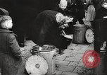 Image of European children and adults scavenge for food and relief after war Europe, 1945, second 38 stock footage video 65675063144