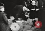 Image of European children and adults scavenge for food and relief after war Europe, 1945, second 39 stock footage video 65675063144