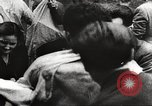 Image of European children and adults scavenge for food and relief after war Europe, 1945, second 59 stock footage video 65675063144