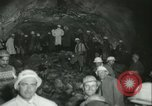 """Image of """"Holing through"""" of tunnel in Mont Blanc Europe, 1962, second 29 stock footage video 65675063219"""