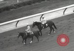 Image of horse racing United States USA, 1964, second 8 stock footage video 65675063245