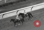Image of horse racing United States USA, 1964, second 9 stock footage video 65675063245