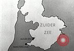 Image of dam on Zuider Zee Netherlands, 1940, second 12 stock footage video 65675063271