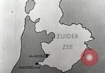 Image of dam on Zuider Zee Netherlands, 1940, second 15 stock footage video 65675063271