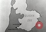 Image of dam on Zuider Zee Netherlands, 1940, second 16 stock footage video 65675063271