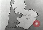 Image of dam on Zuider Zee Netherlands, 1940, second 17 stock footage video 65675063271