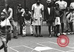 Image of African American children playing games New York United States USA, 1935, second 8 stock footage video 65675063275
