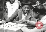 Image of African American children playing games New York United States USA, 1935, second 38 stock footage video 65675063275