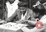 Image of African American children playing games New York United States USA, 1935, second 39 stock footage video 65675063275