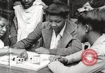 Image of African American children playing games New York United States USA, 1935, second 40 stock footage video 65675063275