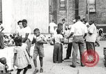 Image of African American children in Harlem New York City USA, 1935, second 3 stock footage video 65675063279